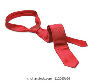 Red men's tie taken off for leisure time, white background isolated