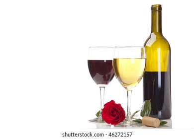Red Merlot and with Chardonnay in wine glasses with bottle, cork, and rose.