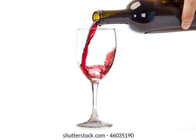 Red Merlot splashing into a wine glass