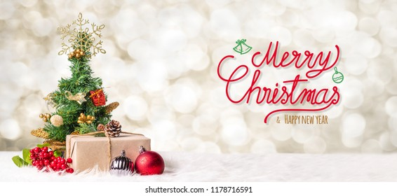 Red Merry Christmas and happy new year handwriting with xmas tree and gift box at blur bokeh light background,Winter holiday banner greeting card