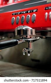 Red metal coffee machine at cafe or restaurant