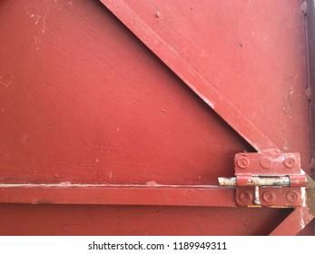 Red metal door with dead bolt