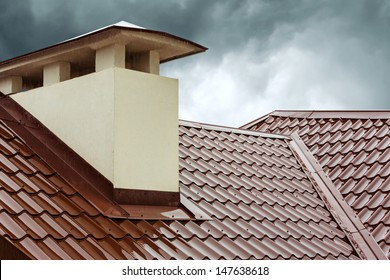 Red metal roof tile and smokestack