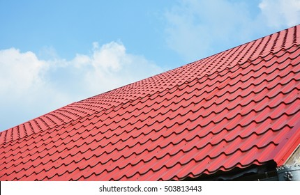 Red metal roof tiles. Metal Roof Shingles - Roofing Construction, Roofing Repair.