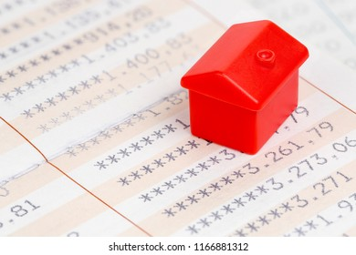 red miniature house on bankbook, concept for house saving