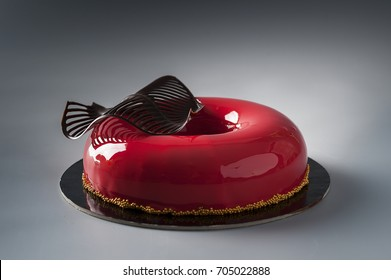 Red mirror glazed entremets with chocolate leaf  decoration