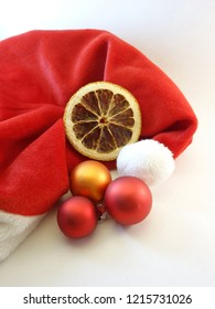 Red mitre, an orange slice and baubles
