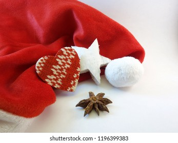 Red mitre, a patterned heart, wooden star and anise