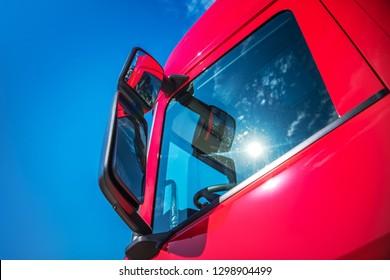 Red Modern Semi Truck Cabin Closeup. Trucking Industry. CDL Concept.
