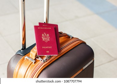 Red Moldavian biometric passport id to travel the Europe without visas. Modern passport with electronic chip let Moldavians travel to European Union without visa