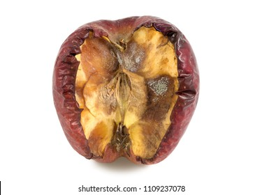Red moldy apple or rotting apple as concept of skin problems, isolated on white background with clipping path.