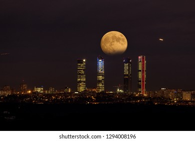 Red moon, eclipse of the moon, four towers, Madrid city Spain