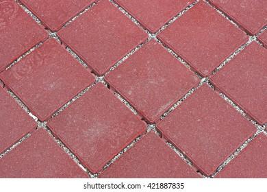 Red mosaic stone outdoor patio floor tiles