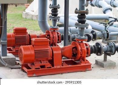 red motor water pump and water pipes