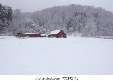 red mountain barn in snow