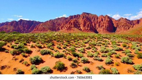 Red Mountainous Desert Landscape With Green Scrub Brush - Utah