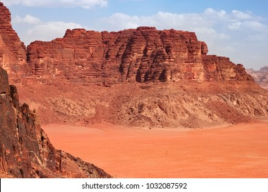 Red mountains of the canyon of Wadi Rum desert in Jordan. Wadi Rum also known as The Valley of the Moon is a valley cut into the sandstone and granite rock in southern Jordan to the east of Aqaba.