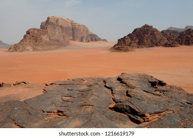 Red mountains of the canyon of Wadi Rum desert in Jordan. Wadi Rum also known as The Valley of the Moon is a valley cut into the sandstone and granite rock in southern Jordan to the east of Aqaba