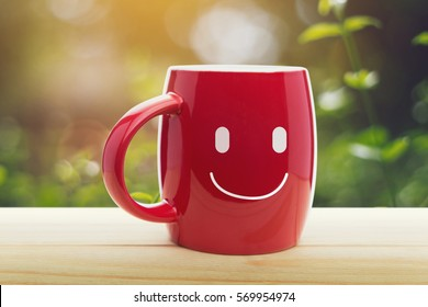 Red mug of coffee with a happy smile, Good day, Good morning or Have a happy day concept