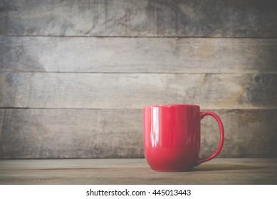 Red mug on wooden