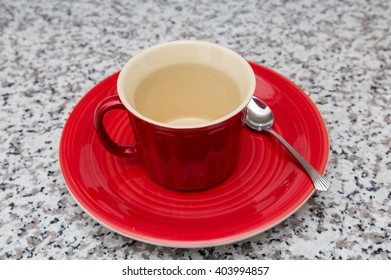Red Mug and Plate on granite countertop