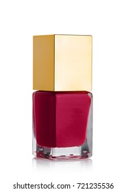 Red nail polish bottle with golden top on white background