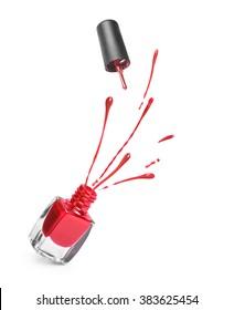 red nail polish bottle with splash isolated on white