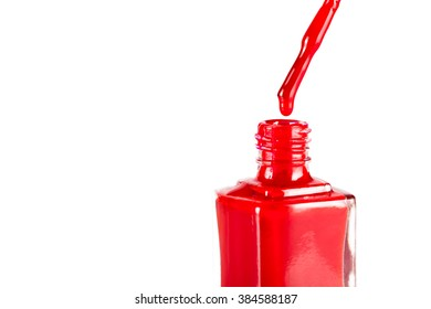 red nail polish closeup on white background