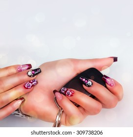 Red nails with ignition key.