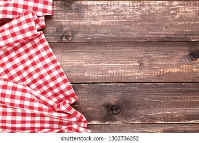 Red napkin on brown wooden table