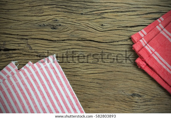 Red napkin on old wooden background. with copy space for text.