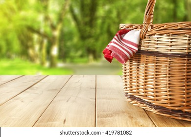 red napkin picnic basket and table place