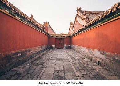 Red narrow passageway in the Forbidden City of Beijing