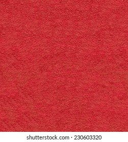 Red natural plush terry cloth turkish bath / beach bathroom towel, textured fabric macro background closeup texture