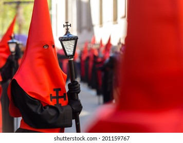 Red nazareno with a lamp in the Good Thursday during Holy Week in Valladolid.