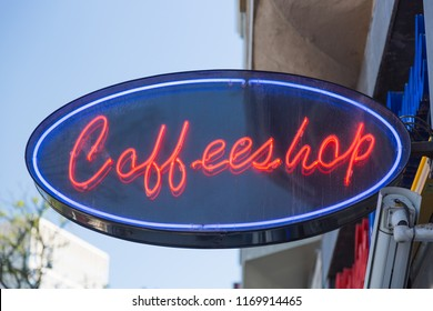 Red neon sign of a Coffeeshop coffee shop in Amsterdam, Netherlands.