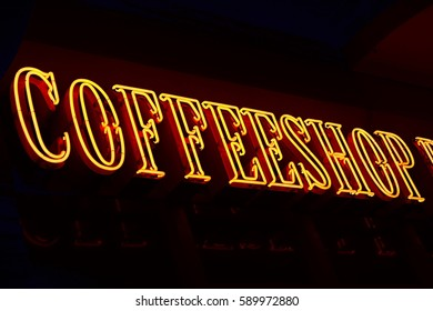 A red neon sign of a Coffeeshop (coffee shop) - selling cannabis (marijuana) in Amsterdam, Holland