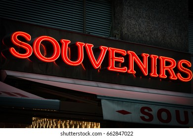 Red neon sign on souvenirs shop in Vienna, Austria. Europe travel.