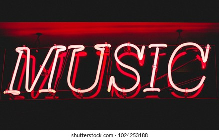 "Red neon sign with the word ""Music"""