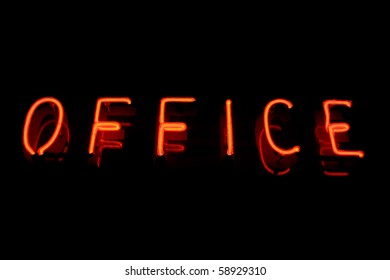 Red neon sign of the word 'Office' on a black background.