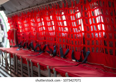 red net seat with seatbelt for paratrooper or airborn forces in military transport aircraft cabin CN 235 with copy space