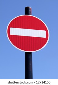 Red no entry road sign.