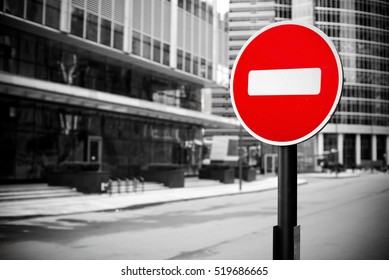 red no entry sign in london street, isolated with black and white background.