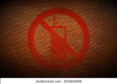 red no mobile phone allowed sign painted on brown leather texture texture background