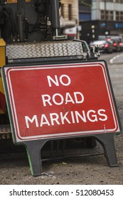 Red No Road Markings sign, board in London.