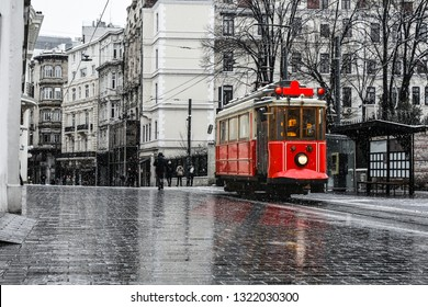 Red nostalgic tram is moving on the Istiklal street in winter day with snow. Istiklal Street is the most popular destination in Beyoglu, Taksim, Istanbul