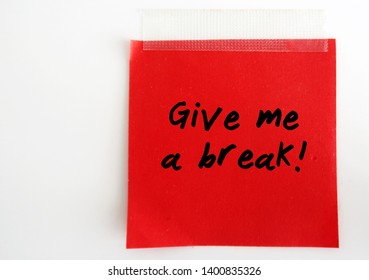 A red note with text written GIVE ME A BREAK ,on white background. concept of telling someone to stop bothering - do not believe what someone said or done.