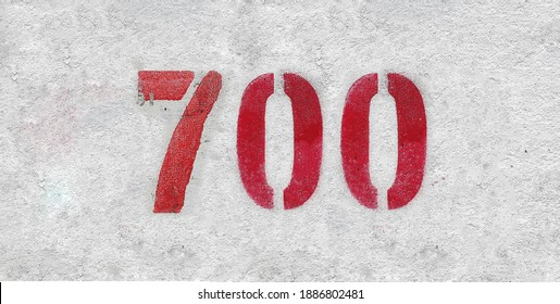 Red Number 700 on the white wall. Spray paint.