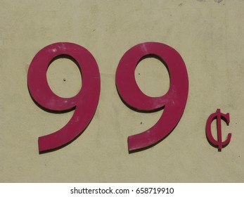 Red numbers and cents symbol displaying 99c on wall of a building
