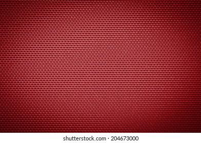 red nylon fabric texture. coarse canvas background - closeup pattern